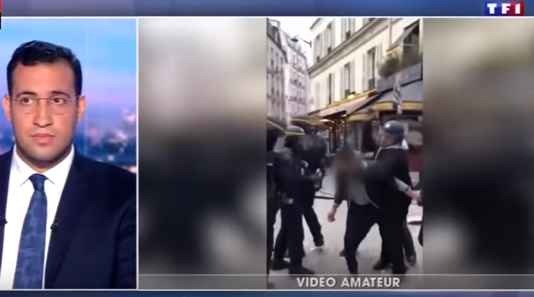 Vidéo montrant Alexandre Benalla lever la main, puis l'abattre sur le manifestant au niveau de la nuque